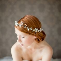 This gorgeous bridal crown can be worn with or without a veil. Take a look...  it's breathtaking.  (by sibo designs)