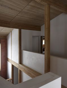 Rothaus | Jonathan Tuckey Design, Andermatt, Switzerland. Engineered larch timber-frame structure, Larch joinery and walls finished in a natural white plaster.