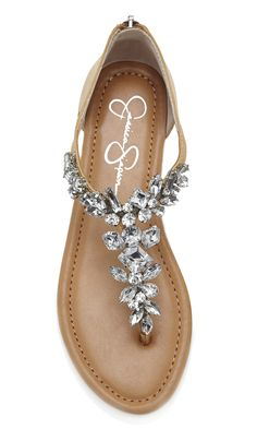 Beige T-strap leather sandals bejeweled with eye-catching crystals and an easy back zipper