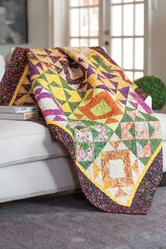 This quilt shows the versatility of simple triangle-squares. Two different blocks create a secondary design when set side by side.