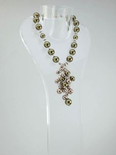 """This unique necklace of metallic green and rose silver shell pearls and German silver and cascading shell pearls on sterling silver chain. 18-21""""L adjustable on stainless steel chain and J-Hook clasp. Yours for only $875"""