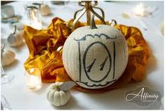 Great for a fall wedding. Pumpkin table numbers and place cards