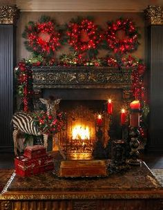 Holiday Mantel Decorating | Love the use of the three wreaths. Red and green colors. Hoping that is not a real zebra, though.