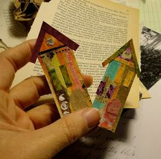 Houses made from scrapbook paper and old book pages