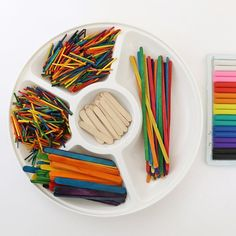 An invitation to create with rainbow modelling clay, craft sticks and toothpicks