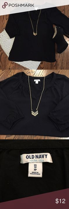 Black 3/4 sleeve Old Navy top This is a wardrobe staple - your basic black top.  It pairs with everything!  This Old Navy top is accented with a split neck and gathering along the collarbone to give it flow.  The 3/4 sleeves are elasticized for a boho vibe.  In very good used condition.  Size XS. Old Navy Tops