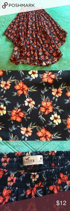 """NWOT Hollister Flowy Navy Floral Print Skirt NWOT summery floral print skirt with an elastic banded waist - 100% viscose - beautiful flowy fullness to skirt - hem length is a bit shorter on the sides than in the front, giving it dimension - measures 22"""" top to bottom on the sides and 31"""" from top to bottom at longest point in the front Hollister Skirts Midi"""