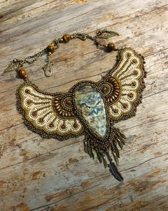 Owl  Necklace Bead Embroidery Art by JewelryElenNoel on Etsy, $395.00 If the cab were lapis or carnelian this could be called Steam Punk Egyptian