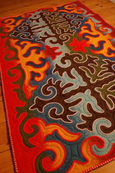 Multicoloured shyrdak felt rug | Unique rugs. I think this is made by a famous shyrdak maker in Tamchi, Kyrgyzstan. Will add her name as soon as I remember it!