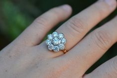 This vintage flower engagement ring boasts over 2 carats of diamonds in an 18K white and yellow gold setting.