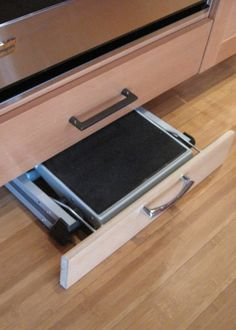 Built-in step stool in the kitchen.