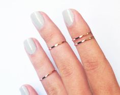 4 Above the Knuckle Rings - rose gold thin shiny bands - set of 4 stack midi rings. $15.99, via Etsy.