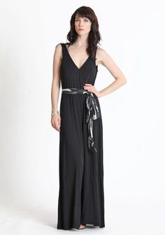 $78.99  Effortlessly fashionable, this black surplice wide leg romper is polished with an optional silky sash. Finished with an elasticized waistline, a hidden snap closure at the bust, and the perfect amount of stretch.