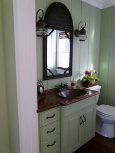 """Beach Cabin Powder Room, This tiny bath was part original, part 80's, and totally void of anything that would suggest """"cabin"""". My husband ma..."""
