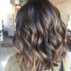 Toned down her previous balayage with a quick gloss to richen and darken her color for the holidays!