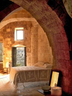 Sextantio Le Grotte, Matera, Italy ~ This romantic hotel features eighteen uniquely converted caves arranged over three levels of a rock face in a cluster of prehistoric cave dwellings, the Civita Caves in Southern Italy.