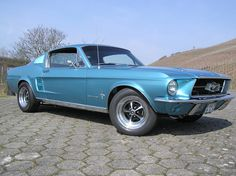 1967 Ford Mustang - my uncle had one like this, but it was a dark blue one. And it had some get up and go when he took it on the road. Ford Mustang 1967, Blue Mustang, Ford Mustang Shelby Cobra, Ford Mustang Fastback, Ford Mustangs, Classic Mustang, Ford Classic Cars, Used Ford, Car Covers