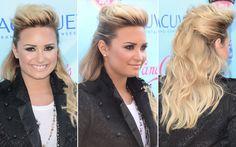 28. Demi Lovato fez um meio rabo com topete bem volumoso. A cantora usou o spray para deixar as laterais do penteado bem puxada e certinha e o comprimento ganhou volume graças a um ondulado bem natural.