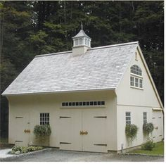 Saltbox roof on quaint garage; cupola; strap hinges on doors