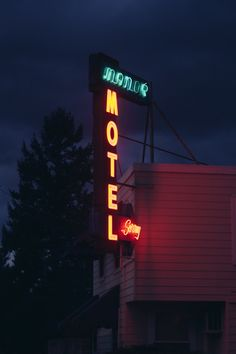 Manor Motel neon sign illuminated in Ashland, OR