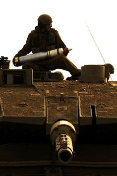 Israeli soldier loading ammunition to Merkava Mk 4 main battle tank