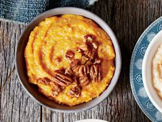 Buttermilk adds a subtle, creamy tang to these stone-ground grits. This spiced pumpkin variation of the classic buttermilk stone-ground grits recipe Pumpkin Spice Syrup, Spiced Pumpkin, Canned Pumpkin, Pumpkin Recipes, Fall Recipes, Grits And Greens, Stone Ground Grits, Spiced Pecans, Best Pumpkin