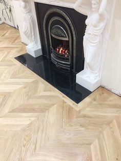 Oak Chevron parquet floor. Detail round the fireplace.