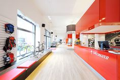 BIKELAND // specialized conceptstore //elongated cash point // in red - company color
