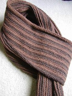 This is a warm thick scarf, with a herringbone design on both sides. pattern available from Ravelry for $6.00 US