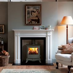 Woodburner with traditional surround nice but to clean a finish for us.
