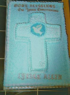 Cross w/Dove Christening Cake  Full sheet frosted in buttercream. 2nd cross shaped cake placed on top.  Hand piping and letters made out of chocolate molds dusted with silver luster dust.