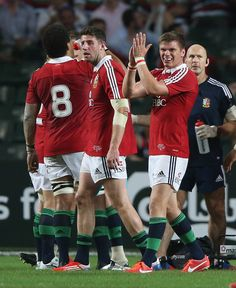 Owen Farrell of the Lions applauds the referee, Steve Walsh after showing the yellow card to Barbarian hooker, Schalk Brits during the match between the British & Irish Lions and the Barbarians at Hong Kong Stadium on June 1, 2013, Hong Kong.