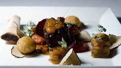 Black Angus Short Rib – Sarawak black pepper glazed Black Angus short rib served with garnish of roasted sweet onions, slow cooked organic tomato & crispy croquettes