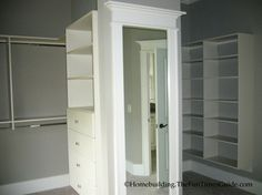 A Custom His & Her Walk-In Closet with Dressing Area