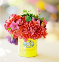 Collect any old colorful tins fill with fresh flowers and you have table decor