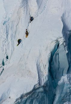 Lucas, Xavier and Renan hiking a steep ledge to reach the spine wall. PHOTOL Tero Repo  | Mission Antarctica expedition blog with Lucas Debari nd Xavier De Le Rue | TransWorld SNOWboarding