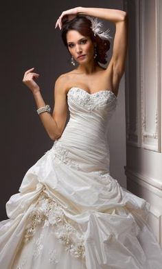 Maggie Sottero Decadence  wedding dress currently for sale at 47% off retail.