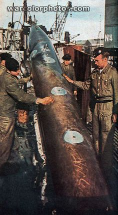 U-boat torpedo.  And those Germans are fondling it a little too much . . .