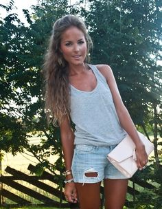 simple grey tank top + light holy shorts. big earrings clutch and bracelets make the outfit