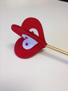 Red queen, Alice in Wonderland scepter... Created by spray painting a wood dowel; connecting to it three red heart sticky felt pads, then adding three smaller white pads and gluing red gems to them. Most supplies from Michaels.  More ideas from this costume are here: https://www.pinterest.com/pin/156359418286667299/