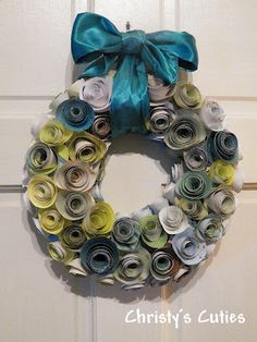 Paper Rose Wreath {Tutorial) Here it is.....      Want to know how to make your own??  Here you go!     This is what you will need:  Wreath (I used a small one)  Paper colors of your choice  Material (for wrapping wreath and bow)  Hot glue and gun