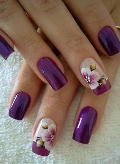 Juicy purple manicure won't let to be unnoticed at work or during a corporate holiday. Large flowers balance the rich purple and the overall impression of