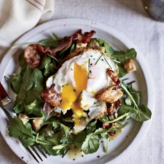 """I like a fried egg,"" says April Bloomfield about the topping on her arugula salad. ""Especially when it's fried in bacon fat."" She likes to use rich d..."