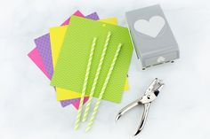 Just in time for spring, kids of all ages will enjoy making a vibrant bouquet of paper heart flowers with colorful scrapbook paper, green paper straws, and a heart paper punch. Toddler Valentine Crafts, Easter Crafts, Crafts For Kids, Flowers For Valentines Day, Straw Crafts, Christmas Coasters, Diy Apartment Decor, Paper Hearts, Paper Straws
