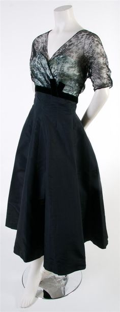 A Navy Taffeta Cocktail Dress,   1952, with a lace overlay at bust, very flared skirt. Labeled: Bergdorf Goodman.
