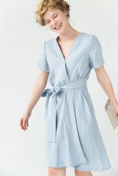 Our light blue washed linen dress, in a classic A line silhouette, is created with a modern wrap dress design. This summer dress is perfect for any occasion, a stroll in the park, relaxing on the beach or enjoying summer festivities. Blue Dress Casual, Blue Summer Dresses, Light Blue Dresses, Dress Summer, Summer Outfits, Cardigan Rose, Wrap Clothing, Clothing Size Chart, Pretty Dresses