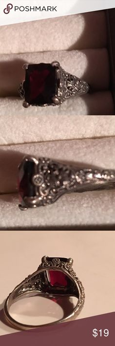Estate 6ct natural Emerald cut Garnet SS Estate 6ct natural Emerald cut Garnet Sterling silver filigree ring. Ring size between 7.5-8. details. (Please be aware that I need up to 1-5 days to ship once purchased due to illness.) Jewelry Rings