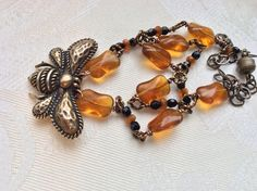 A personal favorite from my Etsy shop https://www.etsy.com/listing/518293085/bronze-bee-and-honey-amber-glass-and