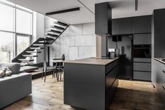 Metal, concrete, floral wood and graphite appear throughout this apartment