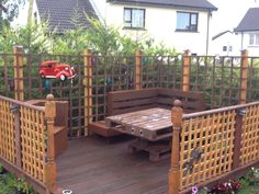 Decking, table, seating and fencing all made from reclaimed wood / pallets
